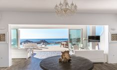 Luxury villa for rent in Mykonos offered by Boni Elite Real Estate. Built on a plot of 7000 square meters overlooking two of the trendiest beaches.