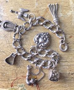 A stunning Victorian large chased link sterling silver charm bracelet with delicate embossed details-Six CHARMS with a large, well detailed