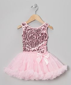 This fanciful dress is a must-have for any little make-believer. A stretchy, sparkling sequin bodice provides a comfortable fit, while a poufy pettiskirt adds a wonderfully whimsical touch.