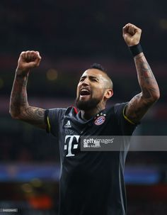 Arturo Vidal of Bayern Muenchen celebrates as he scores their fifth goal during the UEFA Champions League Round of 16 second leg match between Arsenal FC and FC Bayern Muenchen at Emirates Stadium on March 7, 2017 in London, United Kingdom.