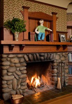 The interior features bold Arts & Crafts woodwork details and a river-rock fireplace in the study.