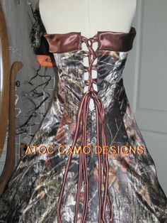 The Big Red Neck Trading Post - Terri-Strapless Camo Gown, $375.00 (http://www.thebigrednecktradingpost.com/products/terri-strapless-camo-gown.html)