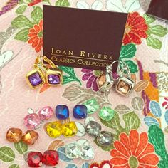 Joan Rivers Interchangeable Earrings Joan Rivers collection interchangeable earrings. Comes with a silver plated pair and a gold plated pair. Also comes with 10 sets of interchangeable stones! This is an adorable set! Please feel free to make an offer!  Jewelry Earrings