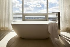 Contemporary bathtub and tiles in a bathroom with view!