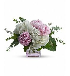 Good and girly! A fabulous pick for a stylish sister, friend or girlfriend, this trendy peony bouquet pairs lush, cloud-white hydrangea with the luscious beauty of pink peonies. The modern feminine arrangement is presented in a fun pink glass cube vase she 's sure to use again and again.White hydrangea and pink peonies are accented with spiral and seeded eucalyptus in a pink glass cube vase.