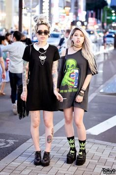 Akane and Christina on the street in Harajuku after dark with tattoos, piercings, platform sandals, and resale items.