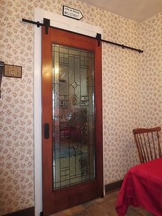 BLACK SHAKESPEARE SINGLE BARN DOOR HARDWARE KIT - note that this left regular trim around door; also, guides at bottom.