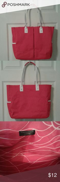 "Lancome Lg tote nwot w/ free gift Dark pink/white nylon tote w/exterior side pockets. 14"" across, 4"" deep, 22.5"" high, 8"" strap drop. Excellent condition. Free gift included, gold tone double zipper pouch, has two compartments, one w/ clear plastic pocket... really nice. Bags Totes"