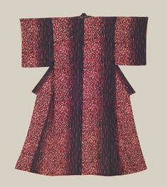 """Kimono, Late Taisho to Early Showa era (1920-1940). A dramatic silk kimono featuring unusual white and red squiggle motifs on a black background.  48"""" from sleeve-end to sleeve-end x 61"""" height.  The Kimono Gallery"""