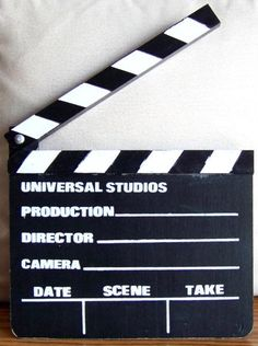 Replica Clapboard obtained Mid-1970s at Universal Studios in Hollywood, Excellent condition/As Issued, painted black and white plywood and wood construction, hinged top film slate clap sticks, size approximately 8 x 7 inches, looks nothing like what Universal currently sells in their gift shops. Nice vintage Universal Studios souvenir. $20