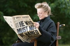 Maggie Smith on the set of Harry Potter, in costume, out of character actually reading the Daily Prophet.
