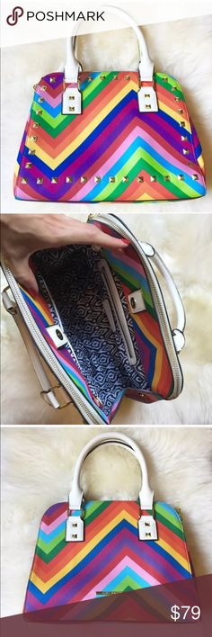 🌈 Steve Madden Rainbow Handbag! GORGE!!! 3 separated compartments for your belongings! Fun ikat printed inside with 2 slide pockets and 1 zipper. Beautiful colors detailed with gold studs!!! Much more justice in person!!! Steve Madden Bags Satchels