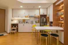 Scandinavian and compact apartment design for couple with two children. Modern Scandinavian Kitchen and Dining Area at the mansion apartment, kemayoran, jakarta