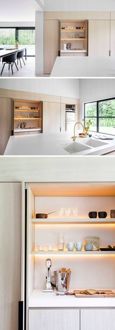 In this modern kitchen, minimalist black cabinet hardware allows you to easily open the cabinet, with the doors folding away within the cabinetry. One design feature hidden within this particular cabinet with an internal countertop, is the LED lighting th Light Wood Kitchens, Modern Kitchen Lighting, Contemporary Kitchen Design, Modern Farmhouse Kitchens, Black Kitchens, Kitchen Black, Kitchen Modern, Modern Contemporary, Contemporary Cabinets