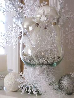 Add some class to a Winter Wonderland Baby Shower with jeweled snowflake baubles and clear vases. | Image via Decor 4 All