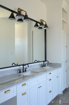 Interesting -black/ORB fixtures, white vanity, marble counter, brass pulls.  Master-Vanity by Wills Casa, via Flickr