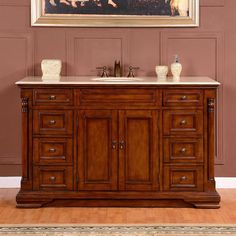 Make this natural stone top vanity with a Crema Marfil marble finish the elegant centerpiece to your bathroom. Featuring an English chestnut finish, the solid wood structure and graceful paneling of this bathroom vanity is perfect for your home.