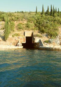 Abandoned submarine base in Boka Kotorska, Montenegro. Note the children on the left, playing.