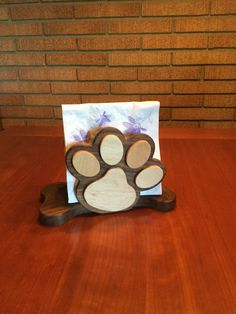 A personal favorite from my Etsy shop https://www.etsy.com/listing/466641564/dog-themed-napkin-holder-walnut-maple