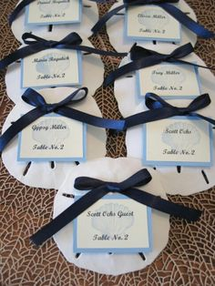 Sand Dollar guest escort & place cards... like the idea of not writing on the sand dollars.