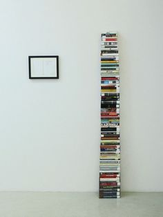 Aaron Kratch. Books stacked to human height, volumes checked out of the New York Public Library with their cover pages stamped to alert the reader that the book's author committed suicide.