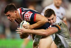 Joseph Manu Photos - Joseph Manu of the Roosters is tackled during the round 13 NRL match between the Sydney Roosters and the Brisbane Broncos at Allianz Stadium on June 2017 in Sydney, Australia. - NRL Rd 13 - Roosters v Broncos Brisbane Broncos, Beefy Men, Rugby League, Roosters, Joseph, Sydney, Football, Journal, Baseball Cards