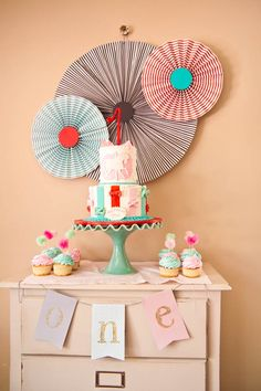 What a sweet first birthday dessert table set up.