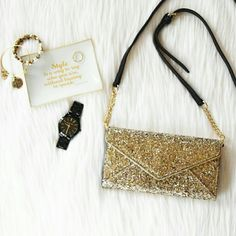 """Rebecca Minkoff Glitter Cleo Wallet On A Chain STUNNING envelope style in sparkling gold glitter  This sleek wallet is roomy enough for your cards and phone. Carry it by hand or sling over your shoulder for hands-free ease. One interior zipper compartment. Four interior slip pockets. Gold hardware. Genuine leather. 7.75""""W x 6.75""""H x 3.75""""D 23"""" adjustable removable chain strap. NWT with authenticity card. Price firm.   NO TRADE/HOLD/PP Rebecca Minkoff Bags"""