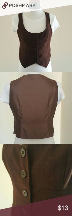 Brown Vest Brown vest w/ 5 buttons in front. Can layer with tees and blazers. Pinstriped detailing in front.  Outer shell is 60% Rayon and 40% Polyester.  Inner lining is 55% nylon and 45% polyester. New York & Company Jackets & Coats Vests
