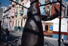 Alex Webb - Havana. 2005. Centro Habana. Santeria influenced murals and sculpture.
