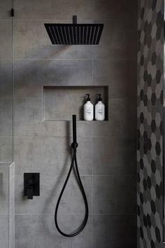 Matte Black Accents Add Sophistication To This Grey And White Bathroom : In this modern bathroom, the shower has a matte black rainfall shower head and a hand held shower head, as well as a tiled built-in shelf. Bathroom Tile Designs, Modern Bathroom Design, Bathroom Interior Design, Bathroom Ideas, Bathroom Remodeling, Bathroom Mirrors, Shower Designs, Modern Bathrooms, Master Bathrooms