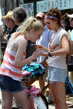 Dakota Fanning and Elizabeth Olsen on the set of Very Good Girls in Brooklyn