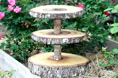 Rustic wedding decoration, cupcake stand, tree slice, woodland, center piece. $79.95, via Etsy.