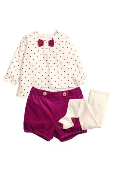 3-piece set: Set consisting of a top, shorts and tights. Wide, long-sleeved top in soft jersey with print spots, press-studs at the back of the neck and elasticated cuffs. Puff shorts in narrow-wale corduroy with decorative buttons at the front, and elastication around the waist and hems. Fine-knit tights with an elasticated waist.