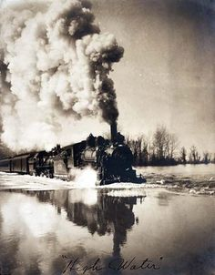 Photo shows view of an Illinois railroad train going through high water. This old photograph dates to 1907.