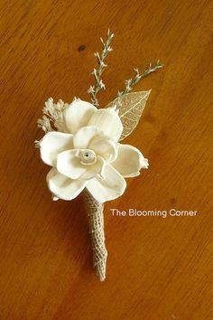 Keep the gold accents but replace the white flower with a blush flower