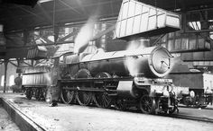 GWR 4-6-0 Saint class No 2988 'Rob Roy' is seen with steam escaping from its safety valves inside one of Tyseley's roundhouses ready to move off shed circa 1930. As can be seen from the photograph above each road radiating from the turntable had a smoke hood at either end to accommodate the locomotive facing in either direction. Built at Swindon works in August 1905 No 2988 remained in service until May 1949 when it was withdrawn from Tyseley shed to be scrapped shortly afterwards by Swindon…