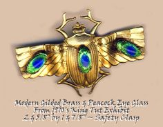 Modern Egyptian Revival Brass Flying Beetle with Peacock Eye Jewels Brooch ~ R C Larner Buttons at eBay  http://stores.ebay.com/RC-LARNER-BUTTONS