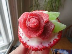 How to decorate a cupcake with roses made from gumdrops or cherry slices candy.