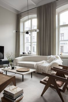 5 Home Renovations That Add the Most Value, relaxing living room, tall ceilings, modern interior, midcentury modern, beige simple curtains, white sofa