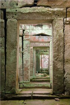 Cambodia ~~~ Looking through a doorway at Preah Khan temple. The symmetry and accuracy of the early Khmer architects is amazing; creating here - doorways that look like a mirror image - a sharp contrast to present day Cambodia.