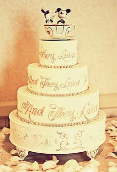Disney wedding cake! LOVE this cake topper! The cake kind of has a vintage, romantic style to it.