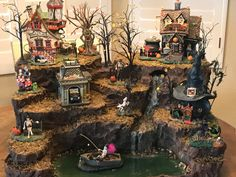 """halloween village Hello there and welcome to and Main"""" custom village displays. This listing is here to get you started on a custom display landscape that I (Nichole) will des Halloween Town, Halloween Village Display, Scary Halloween Decorations, Halloween Halloween, Manualidades Halloween, Christmas Villages, Etsy Christmas, Department 56 Displays, Party Supplies"""