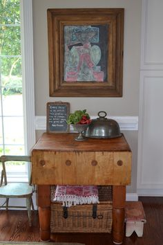 A restored antique butcher's block via Three Pixie Lane