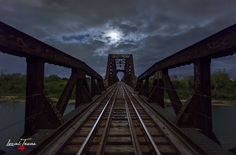 The full moon rises over a train trestle on the Blanco River. Photographic Prints: Photographic prints are available in two finishes – matte and glossy. Matte prints look great in all types of ligh… Full Moon Rising, Moon Rise, Texas Wall Art, Sky Photos, Under The Lights, Types Of Lighting, Photographic Prints, Golden Gate Bridge, Railroad Tracks