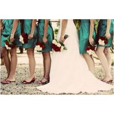 Love the teal dresses with the red shoes and flowers. I also love the bride and maids reversed flower colors.