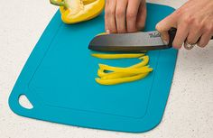 """The flexible, non-slip, and dishwasher-safe Antibacterial Cutting Mat is made from a naturally hygienic and BPA-free, plant-based material.* After washing, roll up the mat and microwave it for 1 minute to kill 99.9% of bacteria.† Its bendable, lightweight design features a groove around its perimeter to trap water or juices from foods. Dimensions: 14"""" x 10""""  *Natural, antibacterial material is shown to help reduce 99.9% of Staphylococcus and Salmonella ..."""