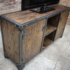 Modern Industrial Furniture- Sixty-two inch Vanderbilt media cabinet, dark matte finish. All solid wood, handscraped and distressed. Sixty-two inch Vanderbilt media cabinet, dark matte finish. All solid wood, handscraped and distressed. Steel Furniture, Unique Furniture, Furniture Projects, Custom Furniture, Furniture Online, Furniture Dolly, Furniture Vintage, Furniture Companies, Furniture Stores