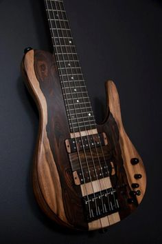 Bass guitar - Fodera Matt Garrison Signature 5 Imperial with a Brazilian Rosewood top. Dat grain...