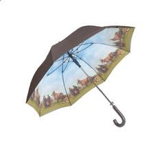 Giving rainy days some equestrian-inspired cheer, the Horse Golf umbrella features an archive horse-and-rider graphic, and a smart Barbour-branded wooden handle